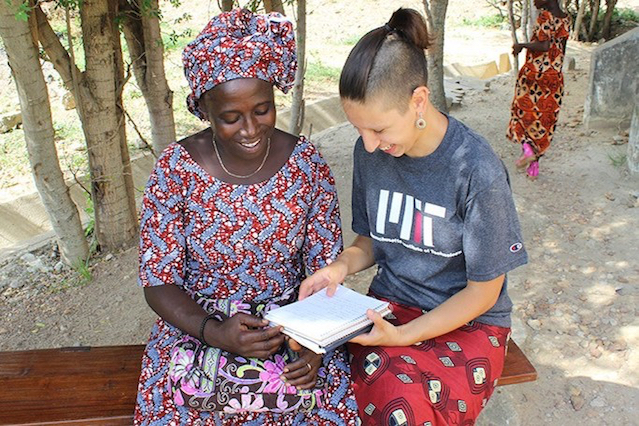 Alicia T. Singham Goodwin '14 working with Takpaya Justine, a community health worker