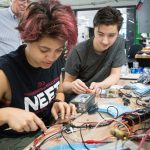 PJ Hernandez (left) and Jackson Gray (right) build circuits in the lab of Professor James Kirtley