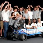 MIT Driverless and TU Delft pose with their race car, DUT18, at Formula Student Germany 2019. The joint team placed third overall.