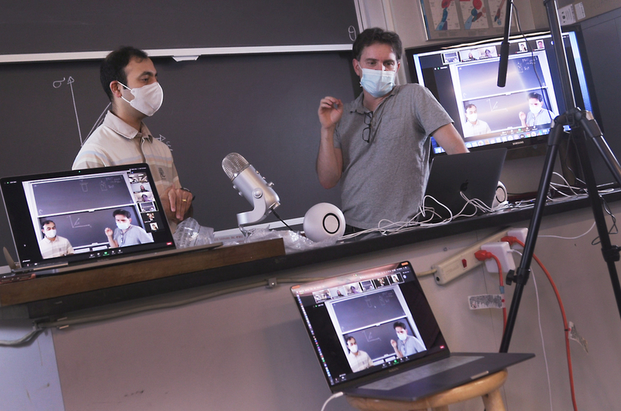 Professors Rohit Karnik (left), associate department head for education in mechanical engineering, and Ken Kamrin test the setup for recording remote lectures in class 2.001 (Mechanics and Materials I). Credits:Photo: John Freidah and Andrea Lehn