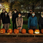 Caption:An October coffee hour event incorporated a pumpkin-carving activity.